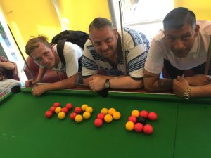 Pool Tournament; players around table